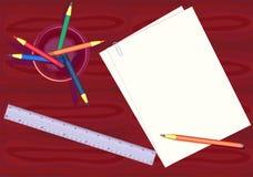 Sheet of a paper and pencils. Color pencils, ruler and sheet of a paper on a table Royalty Free Stock Image