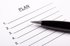 Sheet of paper with plan and pen Royalty Free Stock Photos