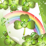 Sheet of paper with rainbow and clover Royalty Free Stock Photo