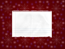 Sheet of paper on red background with snowflakes Stock Image