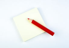 Sheet of paper with red pencil Royalty Free Stock Images