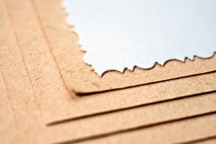 Sheet of paper and rough, textured cardboard stock photos