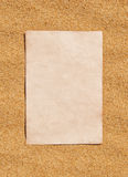 Sheet of paper on the sand Royalty Free Stock Photo