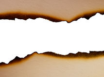 Sheet of paper with the scorched edges close up Royalty Free Stock Images