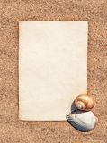 Sheet of paper and seashells on the sand Stock Images