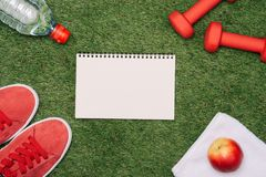 Sheet of paper and sports equipment on grass close-up.  stock photography