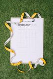 Sheet of paper and sports equipment on grass close-up stock photography
