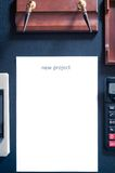 Sheet of paper on a table with the word new project. Insert your text Royalty Free Stock Photo