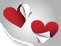 Sheet of paper with two cut-out hearts Royalty Free Stock Photography