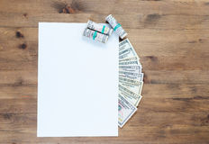 Sheet of paper and US dollar bills Royalty Free Stock Photography