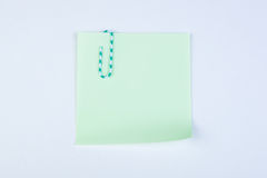 Sheet of paper witn paper clip Royalty Free Stock Photos