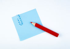 Sheet of paper witn red pencil Stock Photography