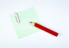 Sheet of paper witn red pencil Stock Photos