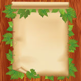 Sheet of paper on wooden board with leaves Royalty Free Stock Photos