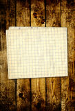 Sheet paper on wooden planks Stock Photos