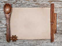 Sheet of paper, wooden spoon and spices Royalty Free Stock Images