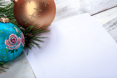 The sheet of paper on wooden table with Christmas Stock Photography
