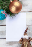 The sheet of paper on wooden table with Christmas Stock Photo