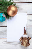 The sheet of paper on wooden table with Christmas Royalty Free Stock Photography