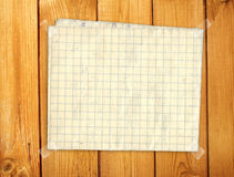 Sheet paper on wooden wall Royalty Free Stock Photo