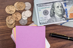 Sheet  with pen and us dollar. Royalty Free Stock Images