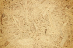 Sheet of plywood with fragments of compressed sawdust Stock Photo