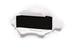 Sheet with rectangular hole. The sheet of paper with the rectangular hole against the black background 2 Stock Image