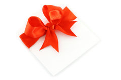 Sheet with red holiday bow Stock Photos