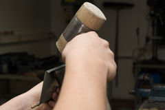 Sheet is seamed with mallet Stock Photography