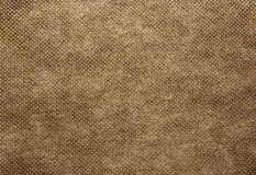 A sheet of thick, coarsely woven fabric in brown colour.Texture. Royalty Free Stock Images