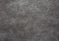 A sheet of thick, coarsely woven fabric in dark grey colour.Text Royalty Free Stock Images