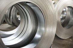 Sheet tin metal rolls. In production hall Stock Photos