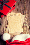 Sheet of vintage paper with gift box and santa's hat Stock Image