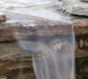 Sheet of water coming off a cascade Stock Images