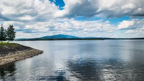 Sheet of water on Lake Namestovo, view of Babia Góra stock photography