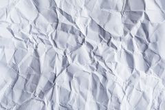 A sheet of white blank crumpled paper as background stock images