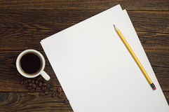 Sheet of white paper and coffee Stock Images