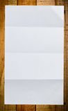 Sheet of white paper on wood Stock Photo