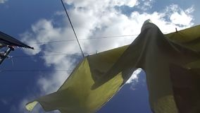 Sheets blowing on washing line. Sheets blowing  on washing line,  on a windy day, with lovely blue sky stock footage