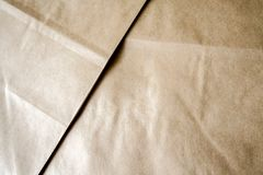2 sheets of brown kraft paper lying on top of each other Stock Image