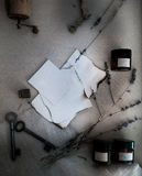 Sheets burnt paper, cans and bottles, old keys, dry lavender. top view Royalty Free Stock Photography