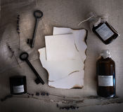 Sheets burnt paper, cans and bottles, old keys, dry lavender. top view Royalty Free Stock Image