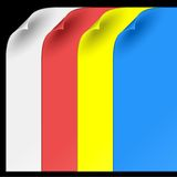 Sheets of color paper with curled corners. On black background Royalty Free Stock Images
