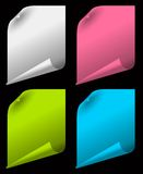 Sheets of color paper with curled corners. On black background Stock Images