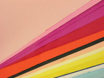 Sheets of Colored Paper. Flat sheets of colored paper, sometimes called construction paper, artistically arranged to expose sheets of varying colors Royalty Free Stock Photo