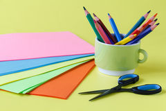 Sheets of colored paper, scissors, glue, pencil,  set for childr Stock Images