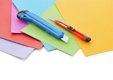 Sheets of colored paper and small stationery knife. Stock Photography