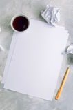 Sheets of empty paper and crumpled paper over concrete backgroun Royalty Free Stock Photos