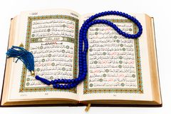 Sheets entire Qoran - Koran - Qur'an with the names of Allah Royalty Free Stock Photography