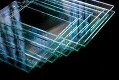 Sheets of Factory manufacturing tempered clear float glass panels cut to size stock photos